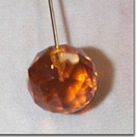 Amber Faceted Glass